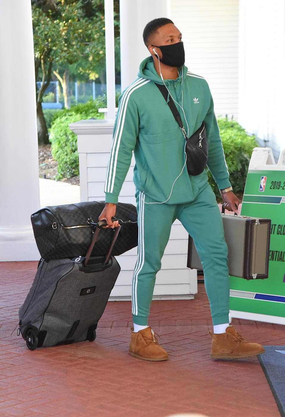 Damian Lillard #0 of the Portland Trail Blazers arrives at the hotel as part of the NBA Restart 2020 on July 9, 2020 in Orlando, Florida. (Photo by Bill Baptist/NBAE via Getty Images)