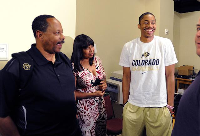 Malcolm and Stephanie Dinwiddie join their son Spencer, right, on Thursday, April 24, 2014, in Boulder, Colo., where the Colorado junior point guard announced he is skipping his senior season and will declare for the NBA basketball draft. (AP Photo/Daily Camera, Cliff Grassmick)