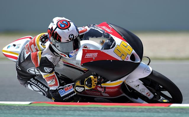 Racing Team Germany's French Louis Rossi takes a curve at the Catalunya racetrack in Montmelo, near Barcelona, on June 1, 2012, during the Moto 3 second training session the Catalunya Moto GP Grand Prix. AFP PHOTO/LLUIS GENE.LLUIS GENE/AFP/GettyImages