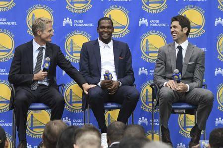 Jul 7, 2016; Oakland, CA, USA; Golden State Warriors head coach Steve Kerr (left), Kevin Durant (center), and general manager Bob Myers (right) address the media during a press conference after Durant signed with the Warriors at the Warriors Practice Facility. Mandatory Credit: Kyle Terada-USA TODAY Sports / Reuters Picture Supplied by Action Images
