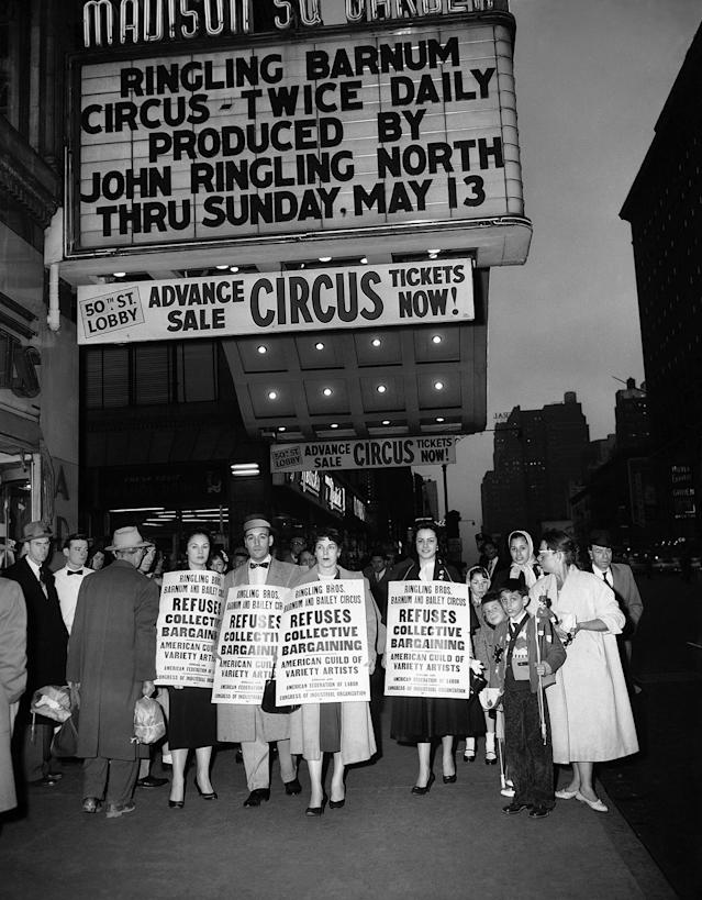 """<p>Pickets for AGVA (American Guild of Variety Artists) parade in front of the entrance to Madison Square Garden in New York, April 6, 1956 where the circus is in its first week. Picketing, banned on April 2 by restraining order issued by justice Thomas A. Aurelio, resumed after Supreme Court Justice Aron Steuer lifted the injunction. """"The situation as regards AGVA reveals a labor dispute so… no injunction can issue in advance of a hearing, """" Judge Steuer ruled. (AP Photo/Tom Fitzsimmons) </p>"""