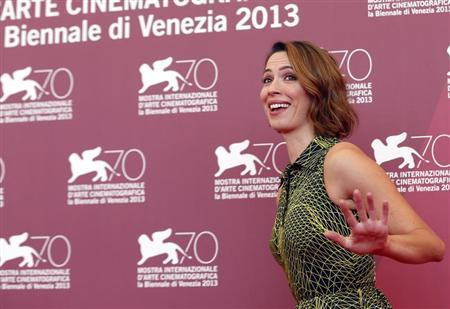 """Actress Rebecca Hall poses during a photocall for the movie """"Une Promesse"""", directed by Patrice Leconte, during the 70th Venice Film Festival in Venice September 4, 2013. REUTERS/Alessandro Bianchi"""