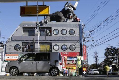 A gorilla statue is seen on top of a building in front of a Shell petrol station in Tokyo, January 9, 2015. REUTERS/Toru Hanai