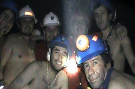 In this handout file photo released by Chile's mining ministry and taken on September 17, 2010, trapped Chilean miners pose inside the San Jose mine during their harrowing ordeal