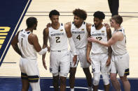 West Virginia forward Derek Culver (1), forward Jalen Bridges (2), guards Miles McBride (4), Taz Sherman (12), and Sean McNeil (22) gather on the court after a foul was called against West Virginia during the second half of an NCAA college basketball game against Texas Saturday, Jan. 9, 2021, in Morgantown, W.Va. (AP Photo/Kathleen Batten)