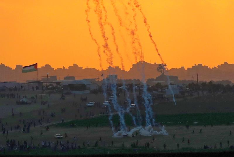 Tear gas rises amidst Palestinian protesters during clashes along the Gaza border in this picture taken from the Israeli side of the frontier on May 15, 2018 (AFP Photo/JACK GUEZ)