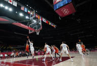 Spain's Laura Gil (24), left, shoots over South Korea's Ji Su Park (19) during women's basketball preliminary round game at the 2020 Summer Olympics, Monday, July 26, 2021, in Saitama, Japan. (AP Photo/Eric Gay)