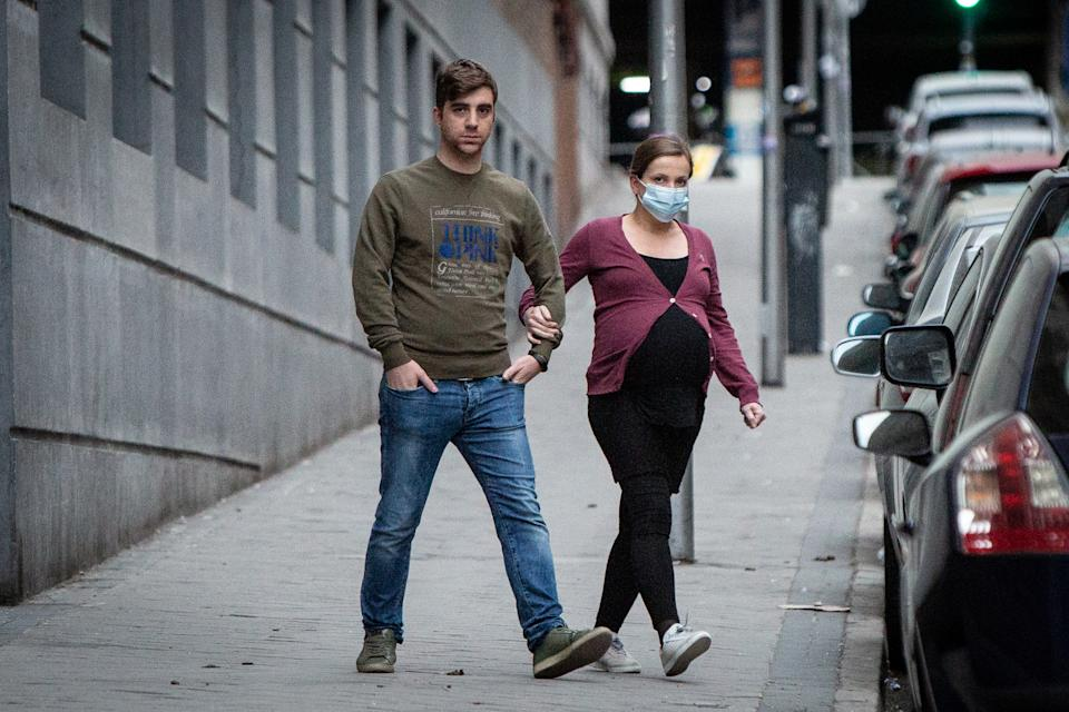 MADRID, SPAIN - MARCH 15: A pregnant woman wears face mask as the country works to stop the spread of the coronavirus on March 15, 2020 in Madrid, Spain. The cases in Madrid are reportedly at least 2,807 people infected of COVID-19 with at least 133 deaths. The Spanish government has declared a state of emergency and is poised to put the country under lockdown to combat the virus.  (Photo by Pablo Cuadra/Getty Images)