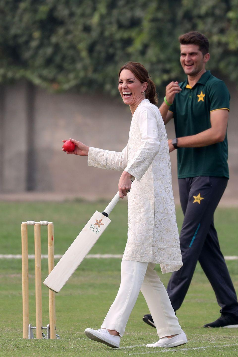 """<p>On <a href=""""https://www.townandcountrymag.com/society/tradition/g29431002/kate-middleton-prince-william-pakistan-royal-tour-photos-2019/"""" rel=""""nofollow noopener"""" target=""""_blank"""" data-ylk=""""slk:a 2019 trip to Pakistan"""" class=""""link rapid-noclick-resp"""">a 2019 trip to Pakistan</a>, Kate visited the National Cricket Academy and tried out the popular sport. </p>"""