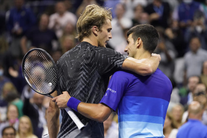 Novak Djokovic, of Serbia, right and Alexander Zverev, of Germany, embrace after Djokovic won their semifinal match of the US Open tennis championships, Friday, Sept. 10, 2021, in New York. (AP Photo/John Minchillo)