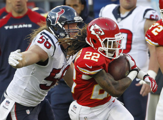 Kansas City Chiefs wide receiver Dexter McCluster (22) is tackled by Houston Texans inside linebacker Brian Cushing (56) during the second half of an NFL football game at Arrowhead Stadium in Kansas City, Mo., Sunday, Oct. 20, 2013. (AP Photo/Colin E. Braley)