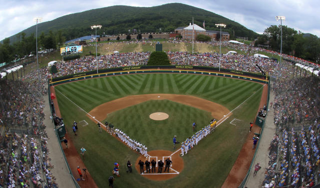 Honolulu, Hawaii, lines the first baseline and South Korea lines the third baseline as the teams are introduced before the Little League World Series Championship baseball game at Lamade Stadium in South Williamsport, Pa., Sunday, Aug. 26, 2018. (AP Photo/Gene J. Puskar)