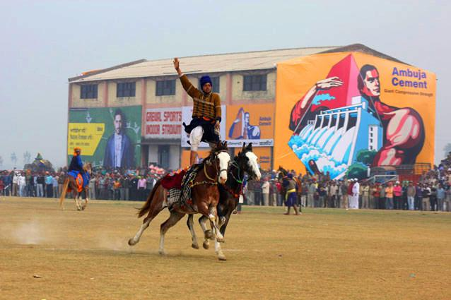Kila Raipur Sports Festival. Photo: Anurag Mallick & Priya Ganapathy - The brainchild of Sardar Inder Singh Grewal, the founder of the Grewal Sports Association, the bizarre sports meet at Kila Raipur near Ludhiana aims to encourage and steer the local youth of Punjab's Doaba belt into sports. Expect tug-of-war, tent-pegging, freestyle kabaddi, and races for camels, elephants, bullock-carts, khachhars (mules), tractors and even 80-year-olds!