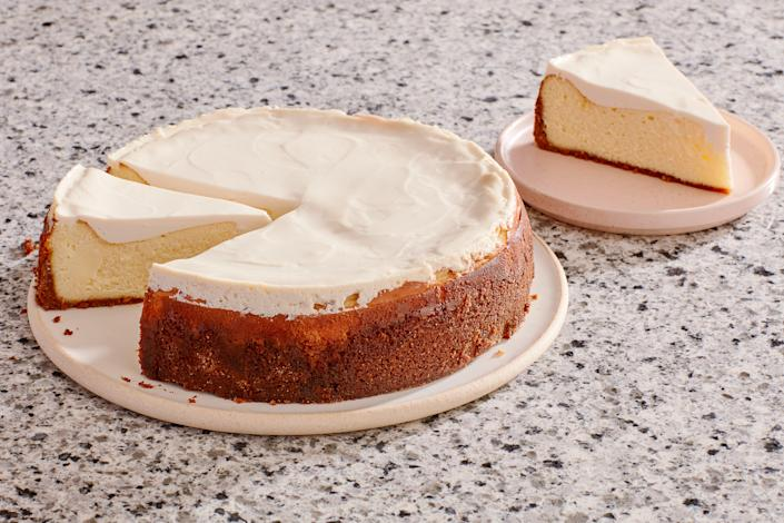 """The tangy sour cream topping on this cheesecake balances the dessert's luscious flavor—and hides any cracks that might have happened in the oven. <a href=""""https://www.epicurious.com/recipes/food/views/three-cities-of-spain-cheesecake-102595?mbid=synd_yahoo_rss"""" rel=""""nofollow noopener"""" target=""""_blank"""" data-ylk=""""slk:See recipe."""" class=""""link rapid-noclick-resp"""">See recipe.</a>"""