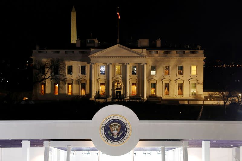 FILE PHOTO: The presidential seal is seen in front of the White House on Pennsylvania Avenue before the Inauguration Day parade for U.S. President-elect Donald Trump in Washington