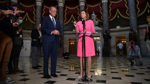 PHOTO: House Speaker Nancy Pelosi speaks, flanked by Senate Minority Leader Chuck Schumer after meeting with the White House Chief of Staff and the US Treasury Secretary on coronavirus relief at the US Capitol in Washington, Aug. 7, 2020. (Mandel Ngan/AFP via Getty Images)