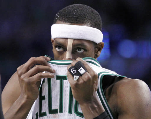 Boston Celtics guard Rajon Rondo (9) wipes his face with his jersey in the second half of an NBA basketball game against the Toronto Raptors in Boston, Wednesday, March 26, 2014. (AP Photo/Elise Amendola)