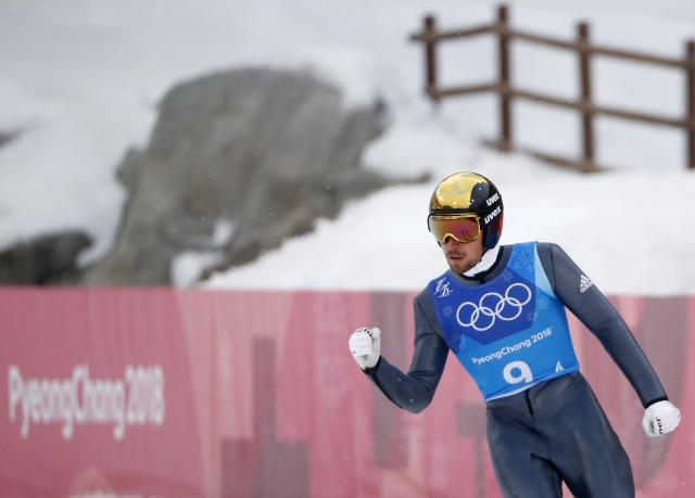 Nordic Combined Events - Pyeongchang 2018 Winter Olympics - Men's Team Gundersen LH Competition - Alpensia Ski Jumping Centre - Pyeongchang, South Korea - February 22, 2018 - Johannes Rydzek of Germany reacts.
