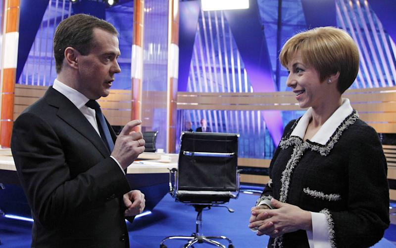 Russian Prime Minister Dmitry Medvedev, left, speaks with REN TV Channel host Marianna Maksimovskaya at Moscow's Ostankino TV Center after a live televised interview on Friday, Dec. 7, 2012. Medvedev answered questions of TV hosts of Russia Federal TV Channels. (AP Photo/RIA Novosti, Dmitry Astakhov, Government Press Service)
