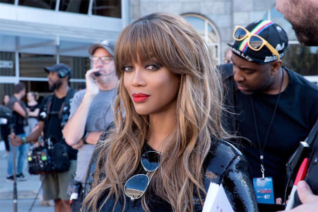 <p>The queen of smizing slayed with this bangin' hair and makeup combo. We love how Banks's full bangs feed into her loose layers, and her blond hair color complements her cherry red lips. (Photo: Instagram) </p>