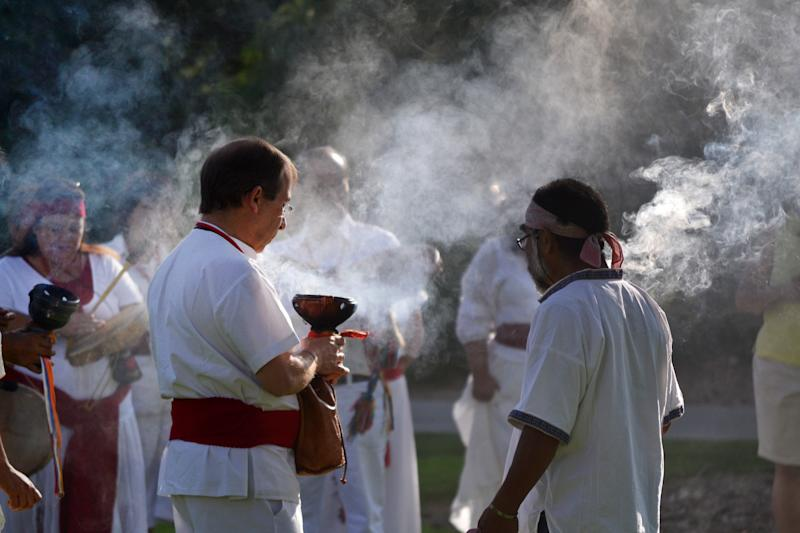 In this July 22, 2012 photo provided by the University of New Mexico, participants of a University of New Mexico workshop on curanderismo, or traditional Mexican folk healing, burn copal during a ceremony on campus. The Maxwell Museum of Anthropology in Albuquerque, N.M. is scheduled to host an exhibit this summer on curanderismo and will invite healers from Latin America to give talks on a traditional healing field that is growing in the United States thanks to immigration from Latin America. (AP Photo/Courtesy of the University of New Mexico)