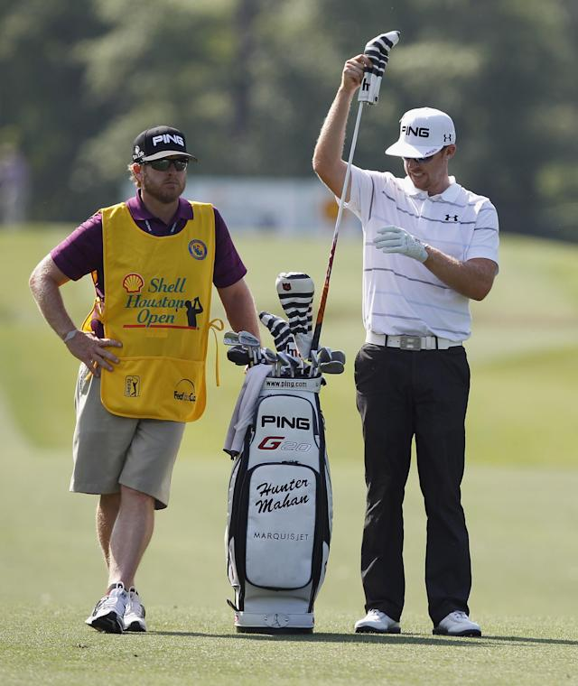 HUMBLE, TX - APRIL 01: Hunter Mahan talks with his caddie, John Wood, before his second shot on the 15th hole during the final round of the Shell Houston Open at Redstone Golf Club on April 1, 2012 in Humble, Texas. (Photo by Matt Sullivan/Getty Images)
