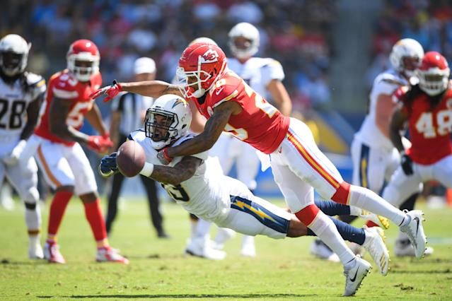 <p>Wide receiver Keenan Allen #13 of the Los Angeles Chargers dives for a pass tackled by cornerback Steven Nelson #20 of the Kansas City Chiefs in the first quarter at StubHub Center on September 9, 2018 in Carson, California. (Photo by Harry How/Getty Images) </p>