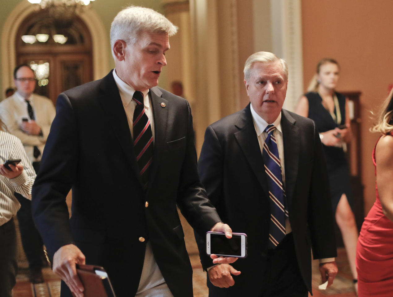 <p> FILE - In this July 13, 2017, file photo, Sen. Bill Cassidy, R-La., left, and Sen. Lindsey Graham, R-S.C., right, talk while walking to a meeting on Capitol Hill in Washington. Senate Republicans are planning a final, uphill push to erase President Barack Obama's health care law. But Democrats and their allies are going all-out to stop the drive. The initial Republican effort crashed in July in the GOP-run Senate. Majority Leader Mitch McConnell said after that defeat that he'd not revisit the issue without the votes to succeed. Graham and Cassidy are leading the new GOP charge and they'd transform much of Obama's law into block grants and let states decide how to spend the money. (AP Photo/Pablo Martinez Monsivais, File) </p>