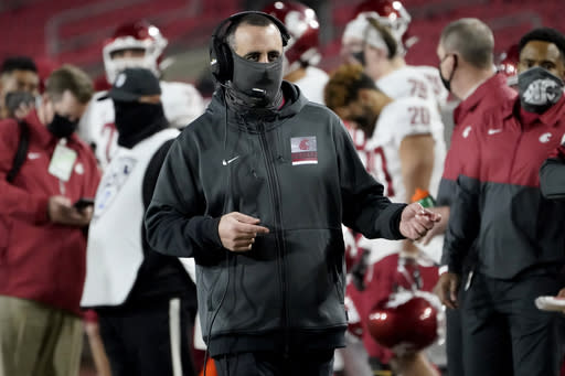 Washington State head coach Nick Rolovich walks the sideline during the second half of an NCAA college football game against Southern California in Los Angeles, Sunday, Dec. 6, 2020. (AP Photo/Alex Gallardo)