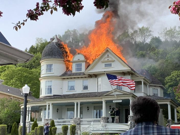 A cottage next to a couple's wedding venue went up in flames, forcing them to move venues during the event. / Credit: Angela Hopkins