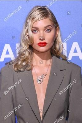 Credit: Getty Images - Elsa Hosk in vintage Versace, paired with a unique TABAYER Fearless Pendant, which is 18 karat white gold, adorned with an emerald and nearly 4 carats of VS+ diamonds; priced at $120,000.