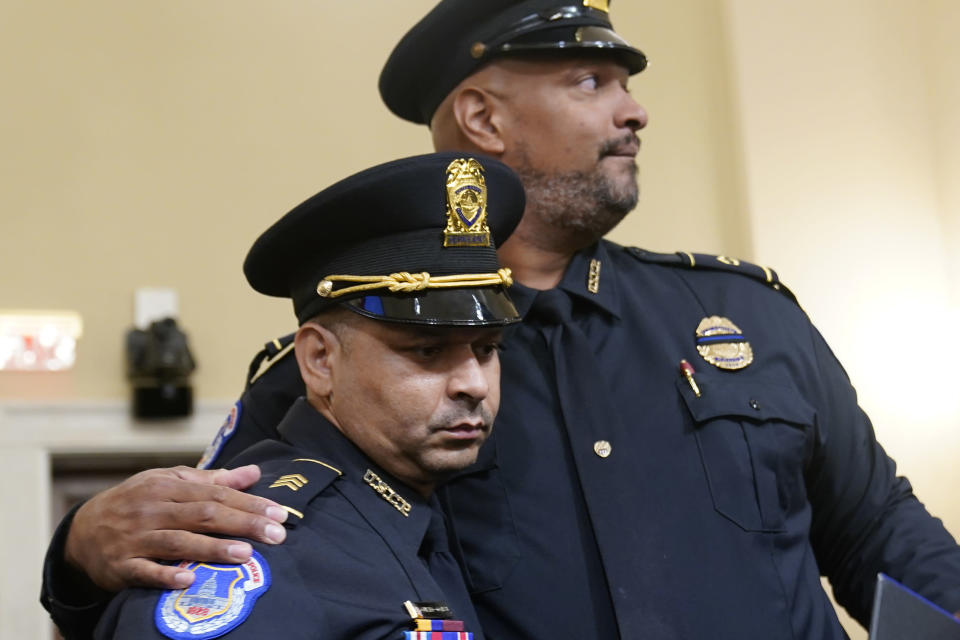 U.S. Capitol Police Sgt. Aquilino Gonell left, and U.S. Capitol Police Sgt. Harry Dunn stand after the House select committee hearing on the Jan. 6 attack on Capitol Hill in Washington, Tuesday, July 27, 2021. (AP Photo/ Andrew Harnik, Pool)