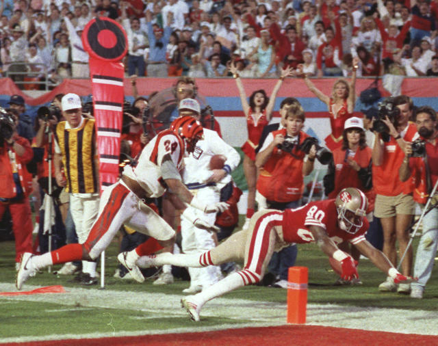 FILE - In this Jan. 22, 1989, file phot0, San Francisco 49ers wide receiver Jerry Rice (80) dives into the end zone for a touchdown during third quarter action in Super Bowl XXIII game against the Cincinnati Bengals in Miami, Fla. Rice, the man with by far the most receiving yards in NFL history sprained his right ankle, which he originally injured in October, during practice the Monday before the Super Bowl. (AP Photo/Phil Sandlin, File)
