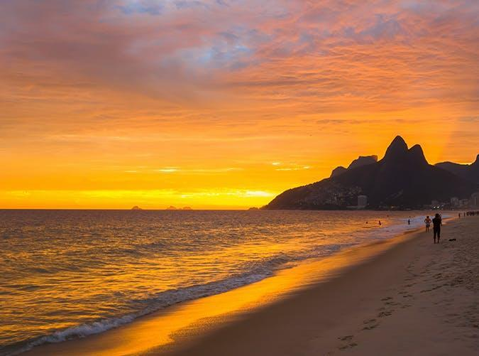<p>There's a reason Rio de Janeiro's famous coastline is one of the most photographed landscapes in the world. It's always summer on the endless stretch of sand framed by the Two Brothers Mountain.</p>