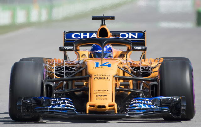 McLaren driver Fernando Alonso, of Spain, drives onto the track during the first practice session at the Formula One Canadian Grand Prix auto race in Montreal, Friday, June 8, 2018. (Graham Hughes/The Canadian Press via AP)