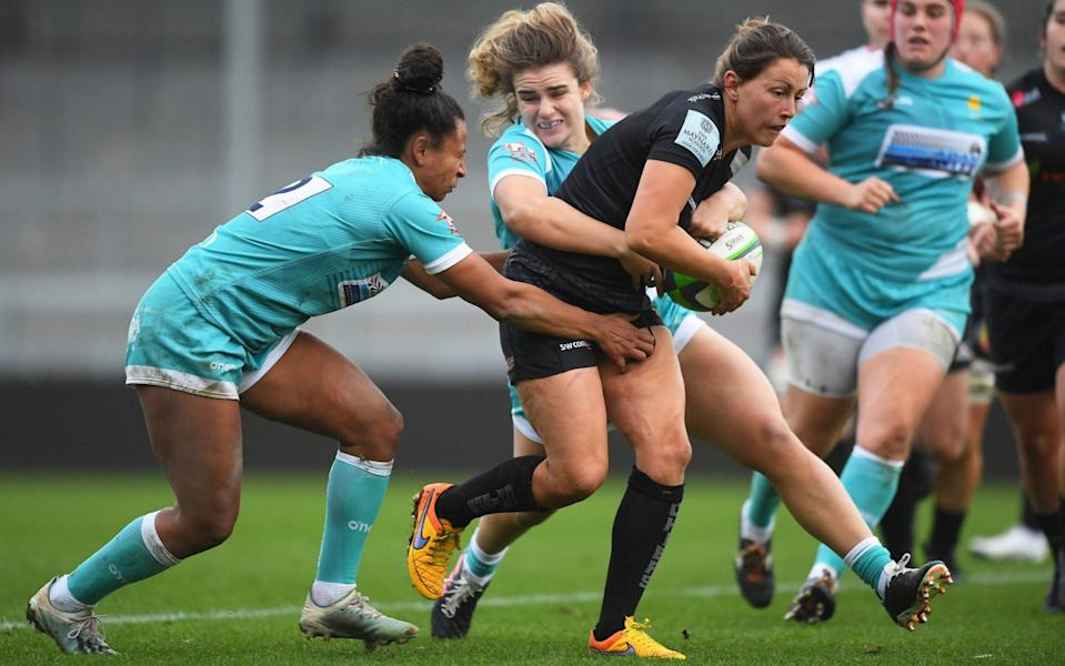 Lauren Cattell of Exeter Chiefs is tackled by Jade Shekells of Worcester Warriors and Abi Kershaw of Worcester Warriors during the Allianz Premier 15s match between Exeter Chiefs Women and Worcester Warriors Women at Sandy Park on November 07, 2020 in Exeter, England. - GETTY IMAGES