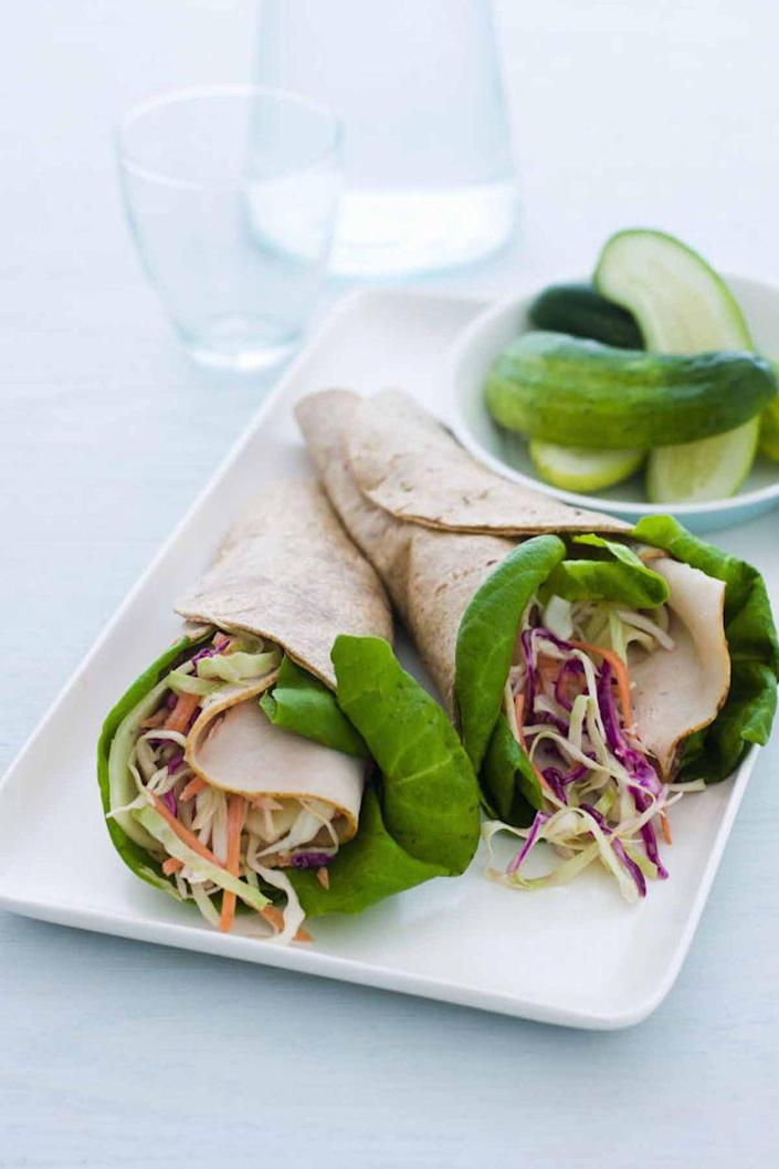 """<p>Tangy flavors collide with this innovative wrap. You'll be satisfied after tasting the assortment of vegetables and seasonings. </p><p><a href=""""https://www.womansday.com/food-recipes/food-drinks/recipes/a10265/asian-turkey-wraps-recipe-121899/"""" rel=""""nofollow noopener"""" target=""""_blank"""" data-ylk=""""slk:Get the recipe for Asian Turkey Wraps."""" class=""""link rapid-noclick-resp""""><u><em>Get the recipe for Asian Turkey Wraps.</em></u></a></p>"""