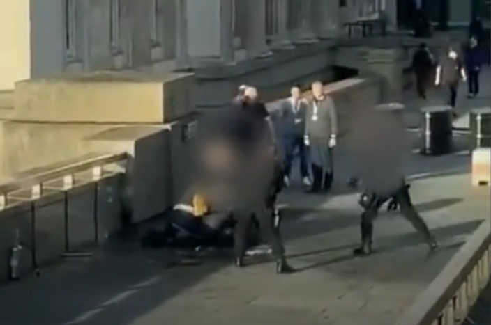 Footage shows a man pinned down by police shortly before he appeared to be shot. Photo: Twitter / @HBOBlog