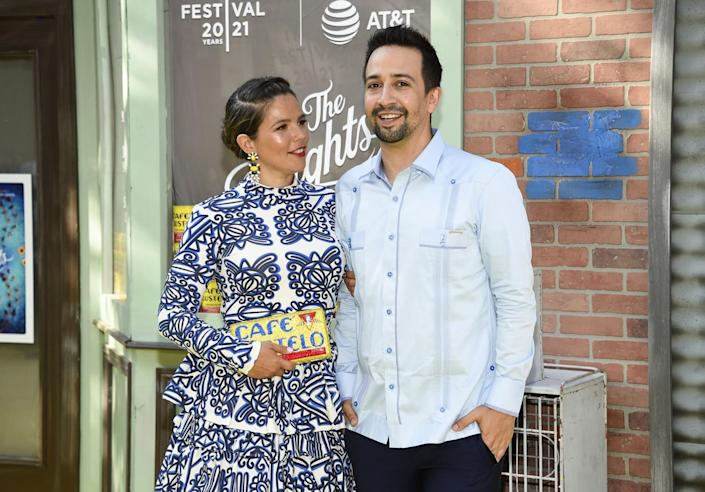 Lin-Manuel Miranda, in a guayabera, and Vanessa Nadal, holding a Cafe Bustelo clutch, on the red carpet