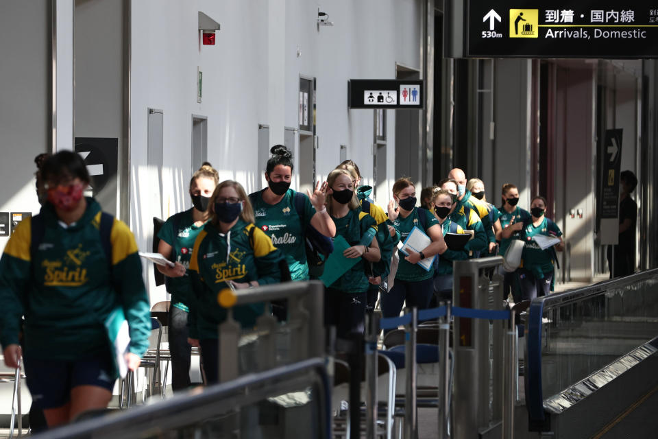 Australian softball national team players arrive at the Narita International Airport in Narita, Chiba, east of Tokyo, Tuesday, June 1, 2021. The Australian team is one of the first teams to arrive ahead of the Tokyo 2020 Olympic games, scheduled to open July 23. (Behrouz Mehri/Pool Photo via AP)