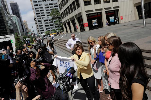 Attorney Gloria Allred holds a shirt with the minimum wages written on it as she speaks on behalf of several former Houston Texans cheerleaders while standing with fellow attorney Kimberley Spurlock outside of NFL headquarters in New York, U.S., June 4, 2018. REUTERS/Lucas Jackson