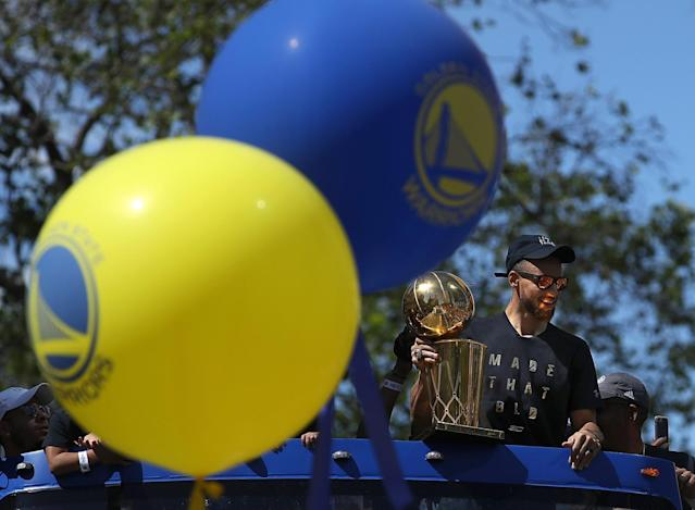 <p>Golden State Warriors Stephen Curry holds the Larry O'Brien NBA Championship Trophy during the Warriors Victory Parade on June 15, 2017 in Oakland, California. An estimated crowd of over 1 million people came out to cheer on the Golden State Warriors during their victory parade after winning the 2017 NBA Championship. (Photo by Justin Sullivan/Getty Images) </p>