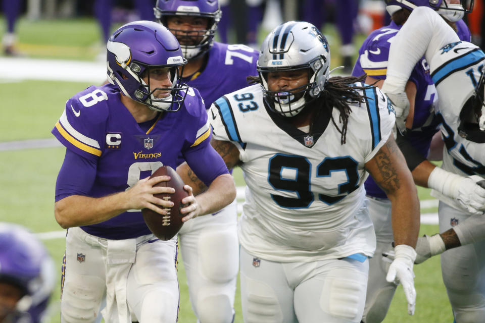 Minnesota Vikings quarterback Kirk Cousins (8) runs from Carolina Panthers defensive tackle Bravvion Roy (93) during the second half of an NFL football game, Sunday, Nov. 29, 2020, in Minneapolis. (AP Photo/Bruce Kluckhohn)