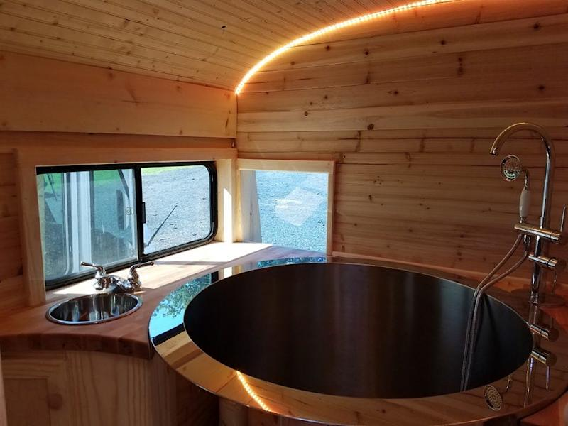 Builder Jeff Flake installed a hot tub in this skoolie conversion.