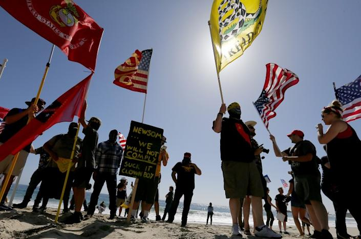 "People gather in Laguna Beach in May to protest Gov. Gavin Newson's order temporarily closing Orange County beaches. <span class=""copyright"">(Luis Sinco / Los Angeles Times )</span>"