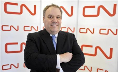 Claude Mongeau poses outside the convention hall before speaking to shareholders at the CN annual general meeting in Edmonton