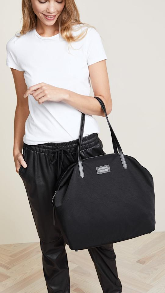 """<p>We love that this <a href=""""https://www.popsugar.com/buy/Rebecca-Minkoff-Nylon-Tote-537117?p_name=Rebecca%20Minkoff%20Nylon%20Tote&retailer=shopbop.com&pid=537117&price=145&evar1=fab%3Aus&evar9=45623846&evar98=https%3A%2F%2Fwww.popsugar.com%2Ffashion%2Fphoto-gallery%2F45623846%2Fimage%2F47066456%2FRebecca-Minkoff-Nylon-Tote&list1=shopping%2Caccessories%2Cbags%2Cworkwear&prop13=mobile&pdata=1"""" rel=""""nofollow"""" data-shoppable-link=""""1"""" target=""""_blank"""" class=""""ga-track"""" data-ga-category=""""Related"""" data-ga-label=""""https://www.shopbop.com/nylon-tote-rebecca-minkoff/vp/v=1/1568085899.htm?fm=search-viewall&amp;os=false&amp;ref=SB_PLP_NB_5"""" data-ga-action=""""In-Line Links"""">Rebecca Minkoff Nylon Tote</a> ($145) is lightweight and has a zipper.</p>"""