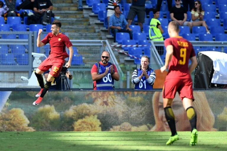 AS Roma forward Stephan el Shaarawy (L) celebrates after scoring against Udinese during the Serie A match against Udinese at the Olympic Stadium in Rome on September 23, 2017