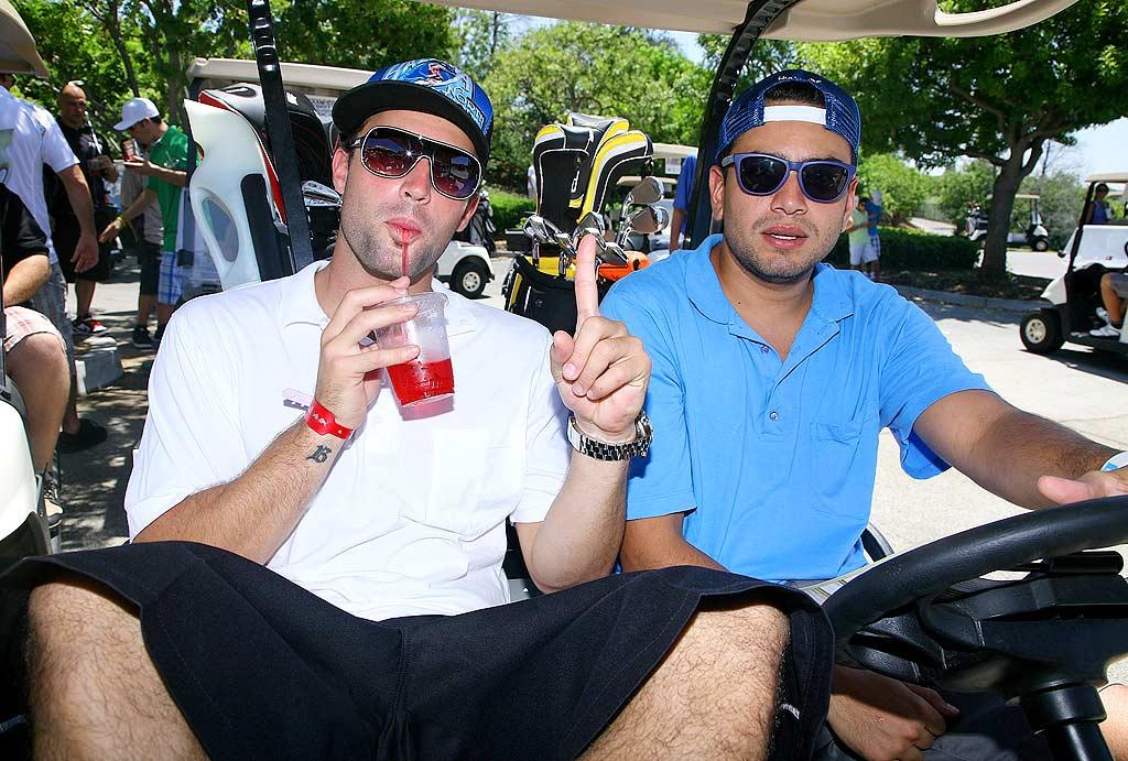 """Brody Jenner and pal Frankie Delgado cruise the course in a golf cart, despite the absence of reality-show cameras. Tiffany Rose/<a href=""""http://www.wireimage.com"""" target=""""new"""">WireImage.com</a> - July 27, 2009"""