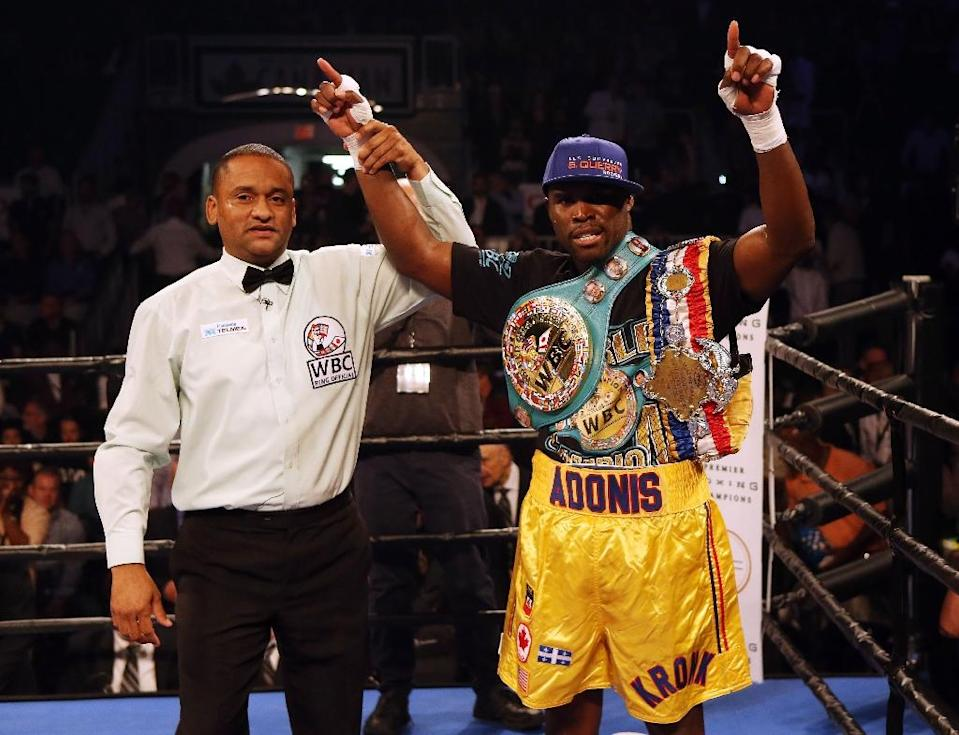 Adonis Stevenson celebrates after defeating Tommy Karpency in their Premier Boxing Champions bout, at the Ricoh Coliseum in Toronto, on September 11, 2015 (AFP Photo/Vaughn Ridley)
